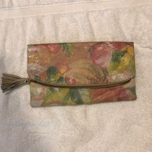 Floral micro suede and leather tassel clutch